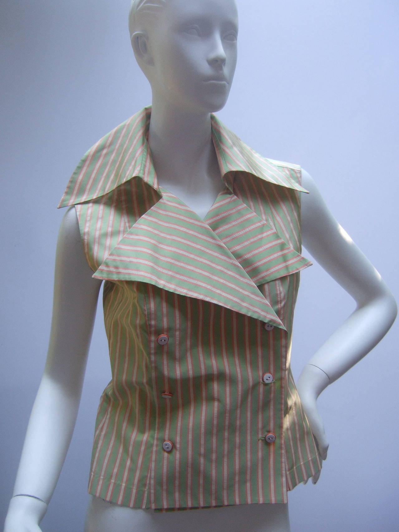 Chanel Striped silk blouse with Chanel buttons Size 38 The unique design is double breasted with six Chanel Paris stamped resin buttons. The crisp double sided silk blouse is a combination of pastachio green, salmon pink & cream stripes. The