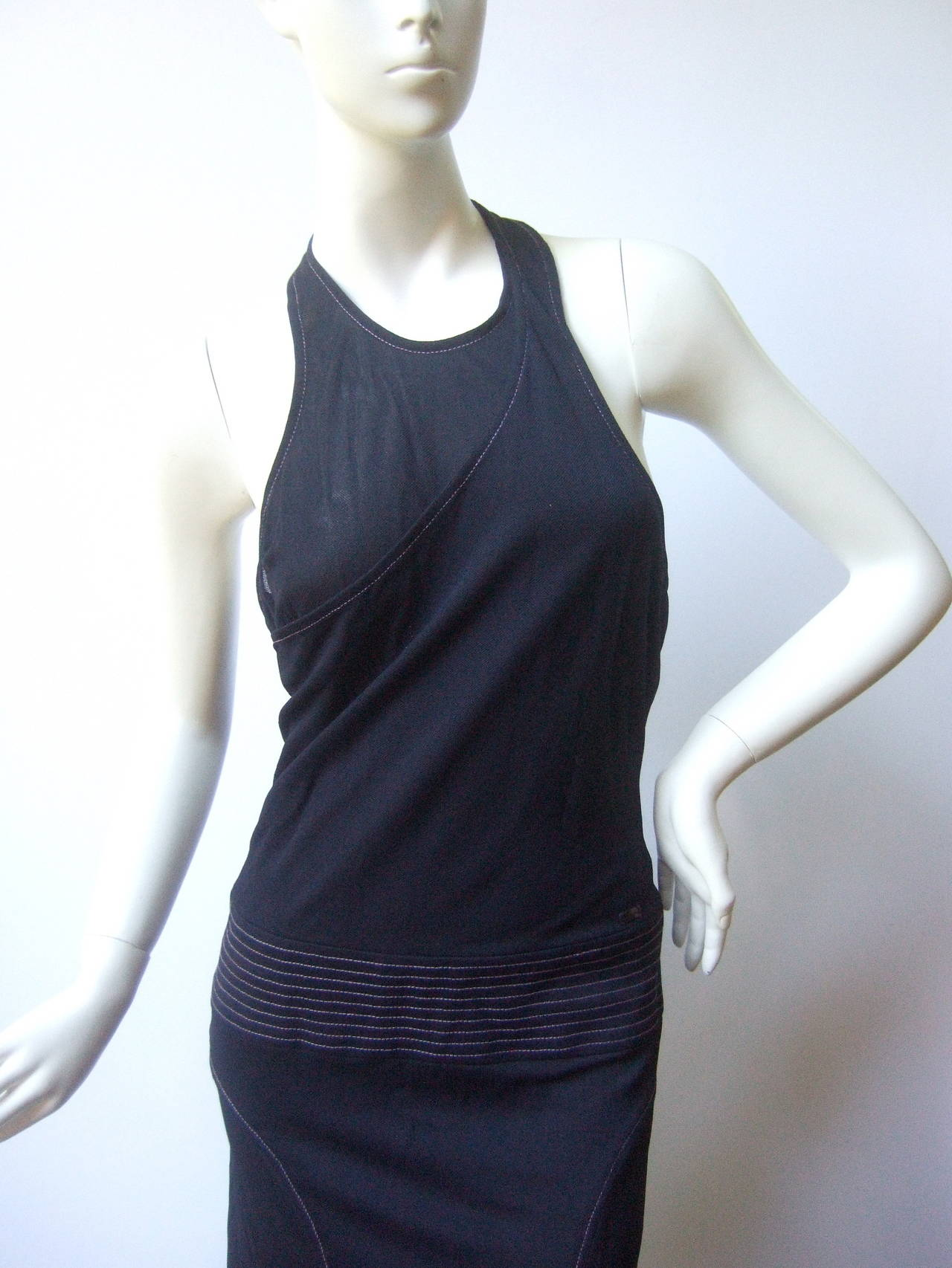 Chanel Sexy midnight blue clingy jersey dress Size 38 The chic dress is designed with a unique silhouette, the top halter section is designed in two distinct fabric panels. One panel covers overlaps the other & the exposed backless design creates a