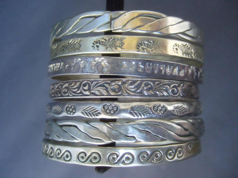 Women's Wonderful Group Of Seven Mexican Sterling Bangle Bracelets c 1960s For Sale