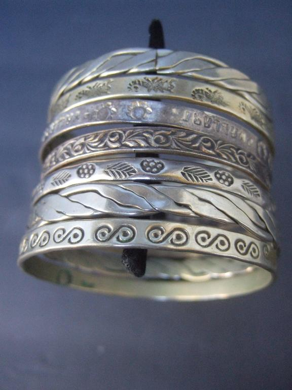 Wonderful Group Of Seven Mexican Sterling Bangle Bracelets c 1960s For Sale 3