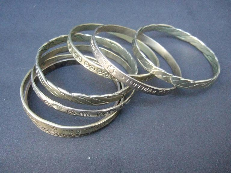 Wonderful Group Of Seven Mexican Sterling Bangle Bracelets c 1960s In Excellent Condition For Sale In Santa Barbara, CA