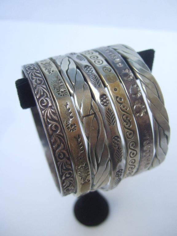 Wonderful Group Of Seven Mexican Sterling Bangle Bracelets c 1960s For Sale 5