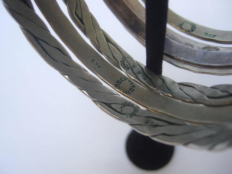 Wonderful Group Of Seven Mexican Sterling Bangle Bracelets c 1960s For Sale 4