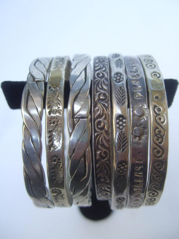 Artisan Wonderful Group Of Seven Mexican Sterling Bangle Bracelets c 1960s For Sale