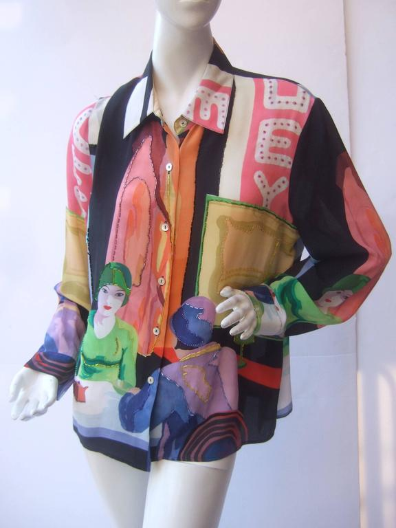 Silk beaded graphic print blouse c 1990s The unique high fashion blouse is illustrated  with a pair of elegant retro style women having tea   The bold graphics are a myriad of pastel colors juxtaposed with black and white color block stripes.