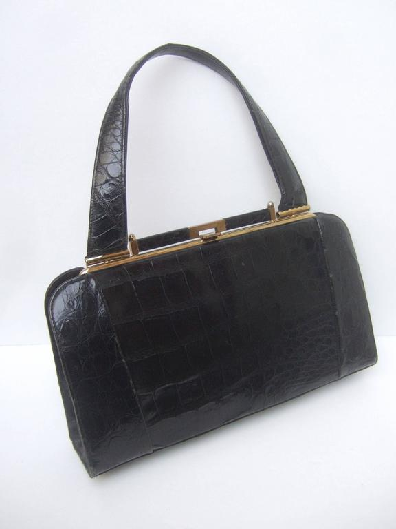 Sleek ebony alligator vintage handbag ca 1960s