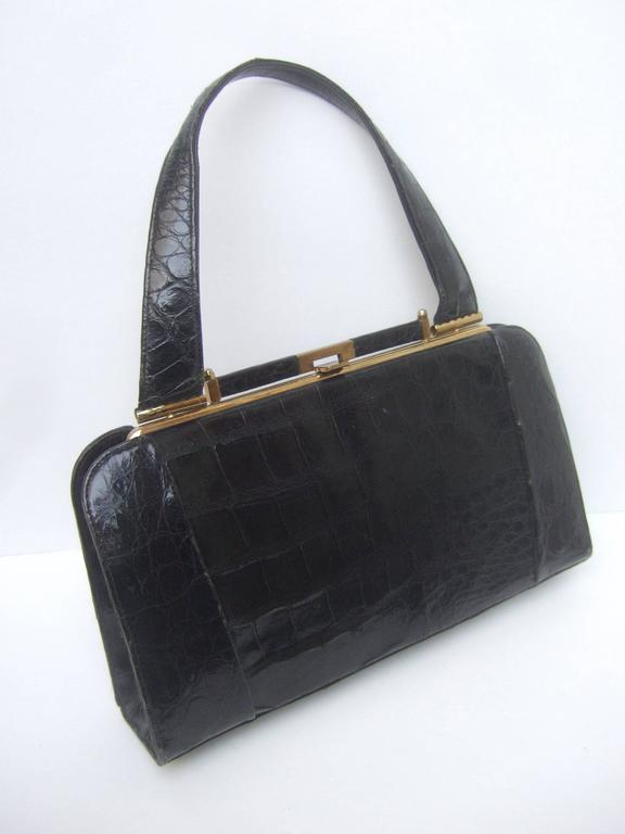 Women's Sleek Ebony Alligator Vintage Handbag ca 1960 For Sale