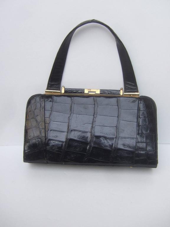Black Sleek Ebony Alligator Vintage Handbag ca 1960 For Sale