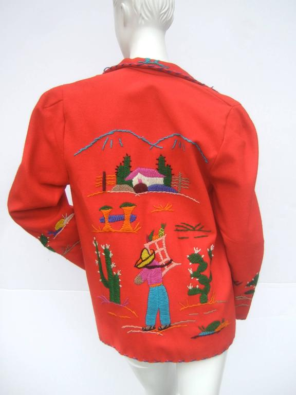 Mexican red felt wool embroidered jacket ca 1950s The unique vintage wool jacket is accented with embroidered cactus and designs  The collar and border edges have contrasting embroidered stitching. The front of the jacket has a deep patch