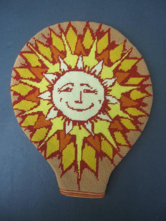 Unique needlepoint sen beam tennis racquet cover c 1970s The needlepoint hand stitched racquet cover is designed with a smiling sun with radiating beams  The back side of the racquet cover is covered with  burnt orange color wide whale corduroy