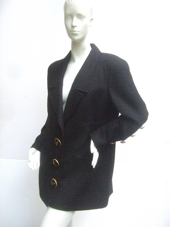Liliane Romi Couture Paris black boucle wool jacket  The stylish designer jacket is adorned with three massive gilt metal buttons that run down the front with L.R. script initials in gilt and black enamel   The sleeves also have five matching