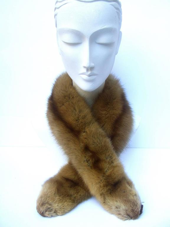 Luxurious plush sable fur collar ca 1960s The elegant sable fur is light & fluffy Running down the center is a darker  brown streak of sable fur   Makes an elegant accessory wrapped  around the neck or draped over the shoulder lapels    Lined in