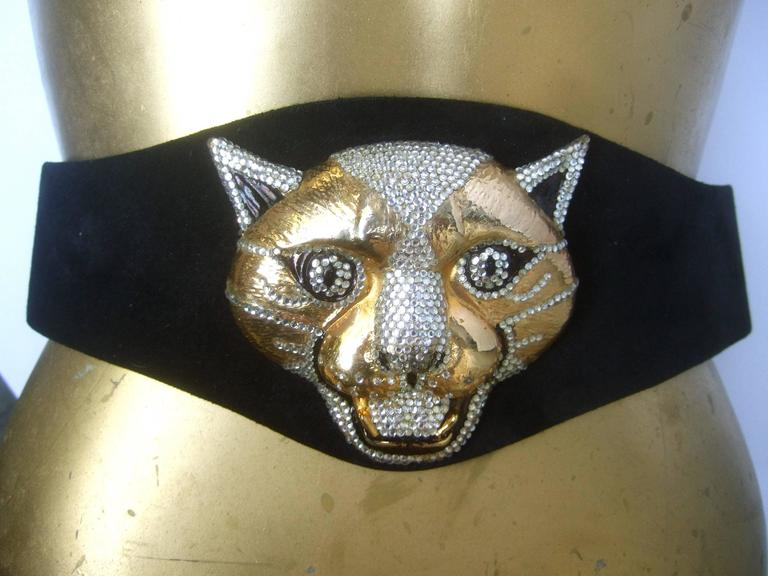 Spectacular massive jeweled suede panther buckle belt c 1970 The incredible belt is adorned with a huge gilt metal  panther's head encrusted with glittering diamante crystals   The panther's face is accented with black enamel  and exposed