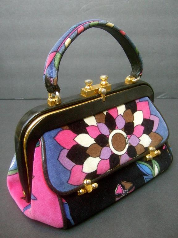 Emilio Pucci Rare velvet leather trim handbag ca 1970 The posh Italian handbag is covered with plush cotton floral print velvet   The velvet covering is illustrated with a mosaic  of vibrant bold graphics with floral motifs Emilio's script name is