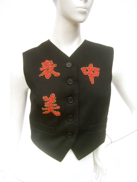 Dolce and Gabbana Exotic glass beaded dragon wool vest Size 42 The Asian theme vest is embellished with a large  scale fire breathing dragon encrusted with intricate glass beading on the back side   The front of the cropped wool vest is adorned with