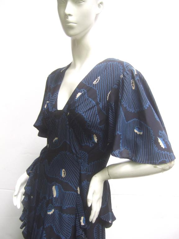 Simply splendid Ossie Clark peplum dress. Amazingly rare black, midnight blue, and white abstract print on moss crepe. Super flattering 1940's style. Gorgeous fluttering sleeves. Fabric designed by Celia Birtwell. Excellent Condition. Labelled Ossie