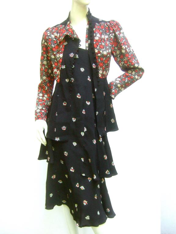 Beautiful Ossie Clark two piece of Celia Birtwell floral printed moss crepe. Halter dress with matching 1930's style flared tie-back jacket. Fabric covered buttons. Excellent Condition. Labelled: Ossie Clark. Measurements: Bust 32 inches Waist: 24