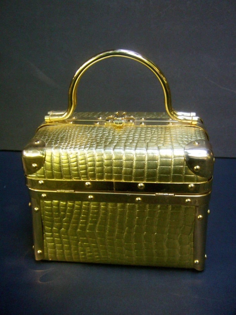Borsa Bella Italy gold metallic embossed box purse c 1980s The stylish Italian box purse is covered with luminous gold embossed vinyl that emulates reptile skin   Designed with a pair of gilt metal swivel handles  Framed with sleek gilt metal trim.