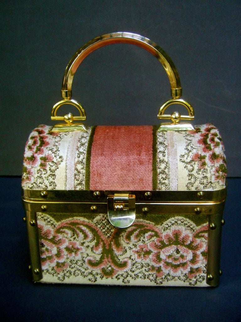 Borsa Bella Italian brocade box purse c 1970s The chic retro handbag is covered with plush  floral brocade juxtaposed with wide solid  panels   Adorned with sleek gilt metal hardware trim and a gilt metal swivel handle. The interior is lined in