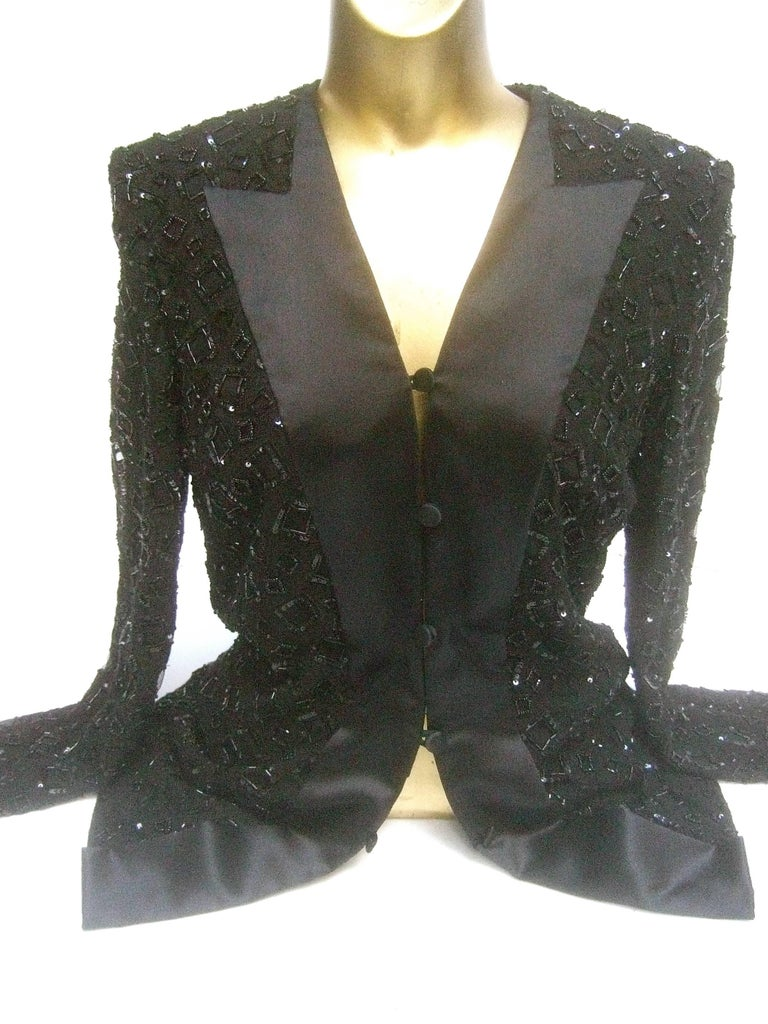 Mirella Cavorso Italian silk black beaded tuxedo style evening jacket  The elegant jacket is embellished with glass bugle beads  combined with tiny sequins in square shaped configurations   The stationary lapels are luminous black silk designed in