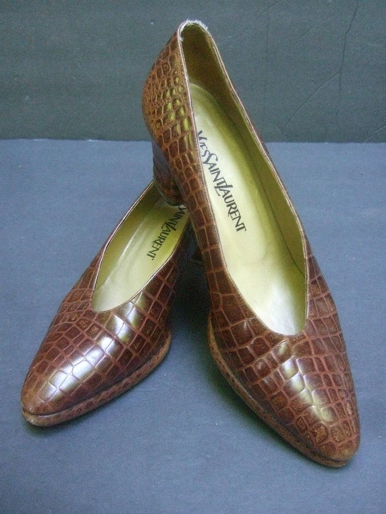 Yves Saint Laurent Italian embossed brown leather pumps US Size 7.5 M The stylish Italian shoes have an embossed finish that emulates reptile skin  The interior is lined in bronze color leather The vintage 1990s era shoes make a classic