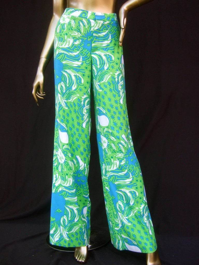 Lilly Pulitzer women's vibrant tiger print slacks US Size 6  The resort-style summer high waisted flared slacks are designed with silk screened tigers head graphics with sinuous wavy manes repeated throughout   The lime green and nautical bright