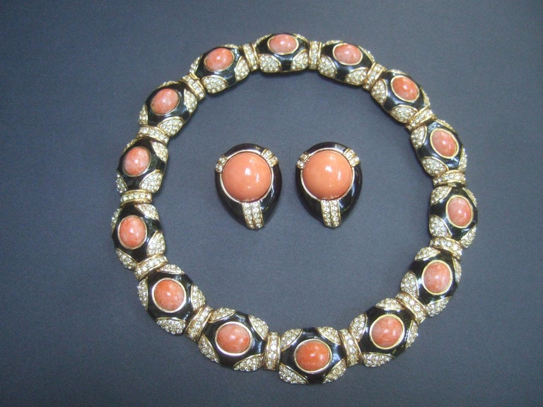 Ciner exquisite coral resin jeweled choker & earring ensemble c 1980s The elegant choker necklace & clip-on earrings are embellished with faux coral resin cabochons, black enamel lacquer with pave  crystals set in gilt metal   The articulated hinged
