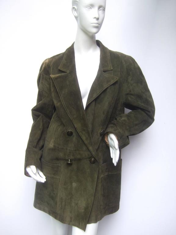 Gucci Italy Moss green suede shabby chic unisex jacket c 1970s The double breasted vintage jacket is designed with plush moss  green suede with G.G. insignia buttons   The interior of the rustic suede jacket is lined in wool with Gucci's