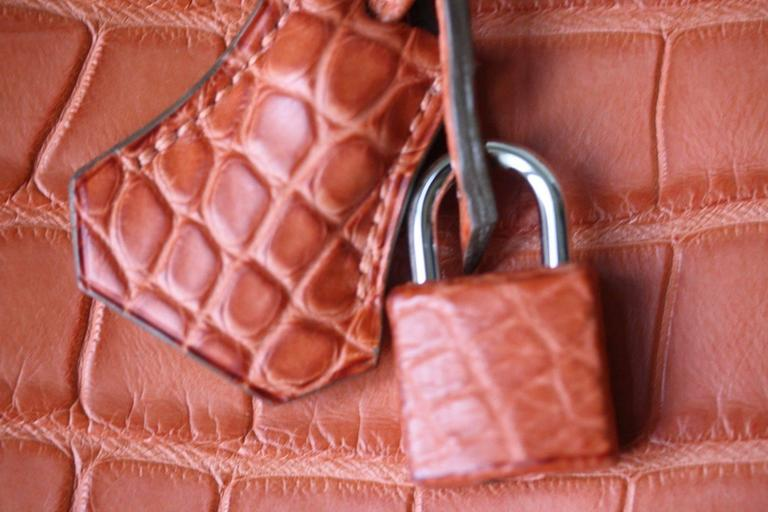 Hermès 40cm Birkin in beautiful Matte Alligator with palladium hardware. Luxuriously rich Hermès orange colour with tonal top stitching.  Year: Date stamp is a O in a square - 2011 production.  Condition: This bag has only been used lightly, there