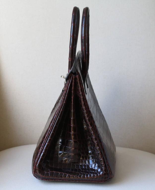 c96db44f8b Hermès 35CM Burgundy Porosus Crocodile Palladium H W Birkin Bag For Sale.  Luxuriously rich burgundy coloured with tonal top stitching.