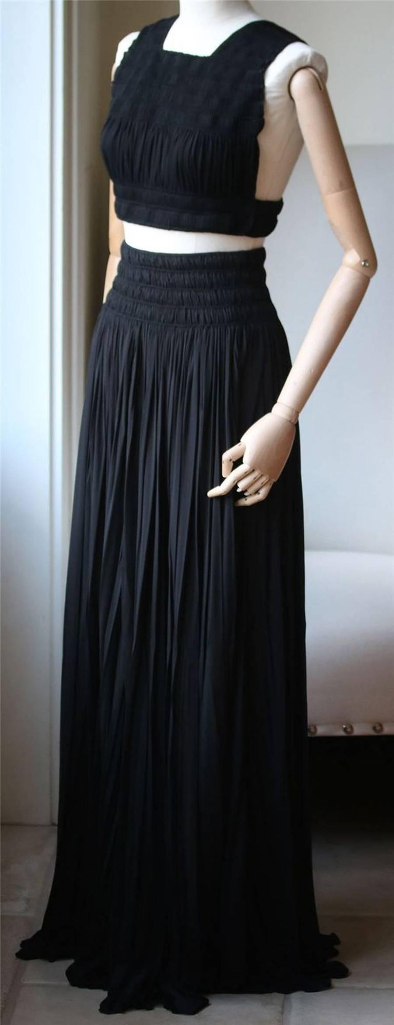 Versatile maxi skirt and top from Alaia. Ruched racerback crop top. Full length. Stretch waist with ruched detail. Pulls on. Unlined.   Size: Top: FR 40 (UK 12, US 8, IT 44). Comes up small. Skirt: FR 38 (UK 10, US 6, IT 42). Comes up