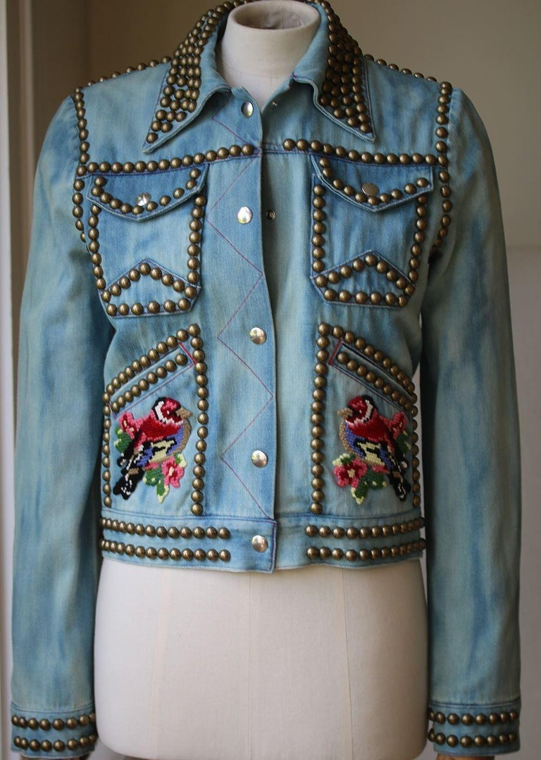 Color Light Blue With Multicolor Details. Pointed Collar. Snap-Buttons Closure Along Front. Two Flap Pockets At Chest, Two Slanted Pockets On Front. Embroidered Patches On Front. Lined. 100% Cotton.  Size: IT 38 (UK 6, US 2, FR 34)  Condition: As