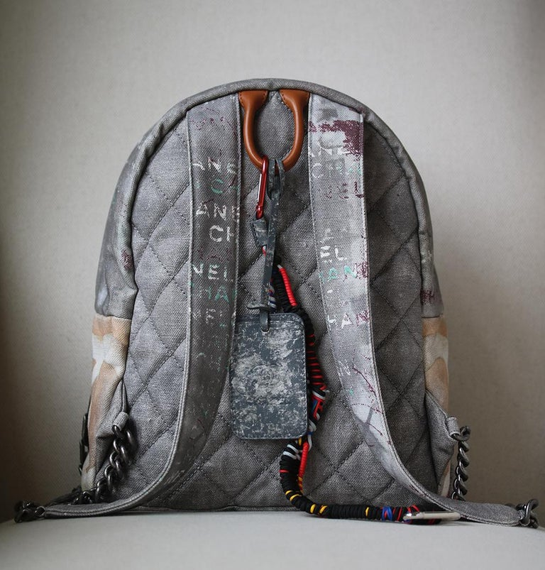 7aa62797ff3c This is the highly sought-after Grey Chanel Canvas Graffiti Backpack from  the Spring 2014