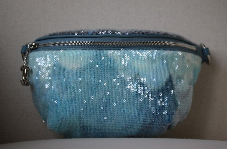 44666502871903 Chanel Sequin Waist Bag Fanny Pack in blue. The bag features a silver  leather threaded