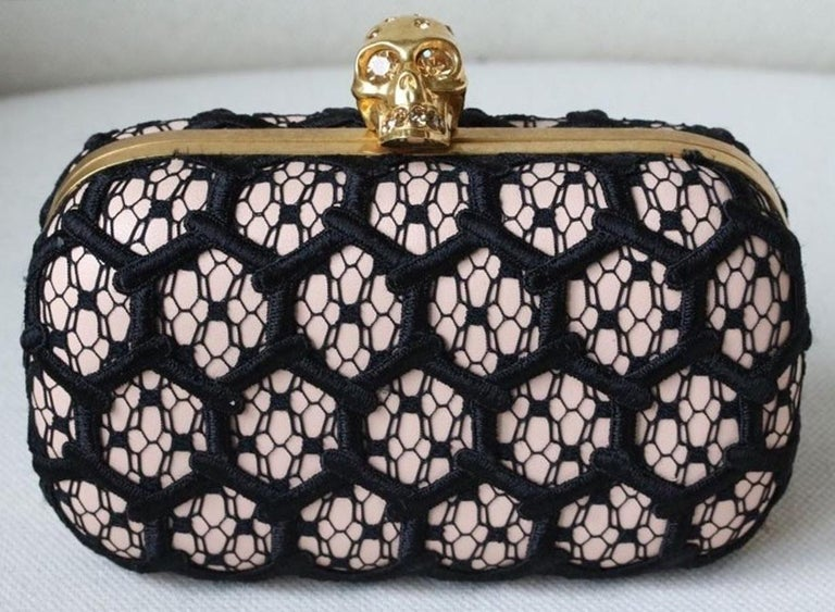Alexander McQueen's box clutch embodies the label's punk-luxe aesthetic. Lace detail embroidery. Pink leather underneath.   Dimension: Approx. 16cm x 10cm x 4cm  Condition: As new condition, no sign of wear.   *Please note, this bag does not come