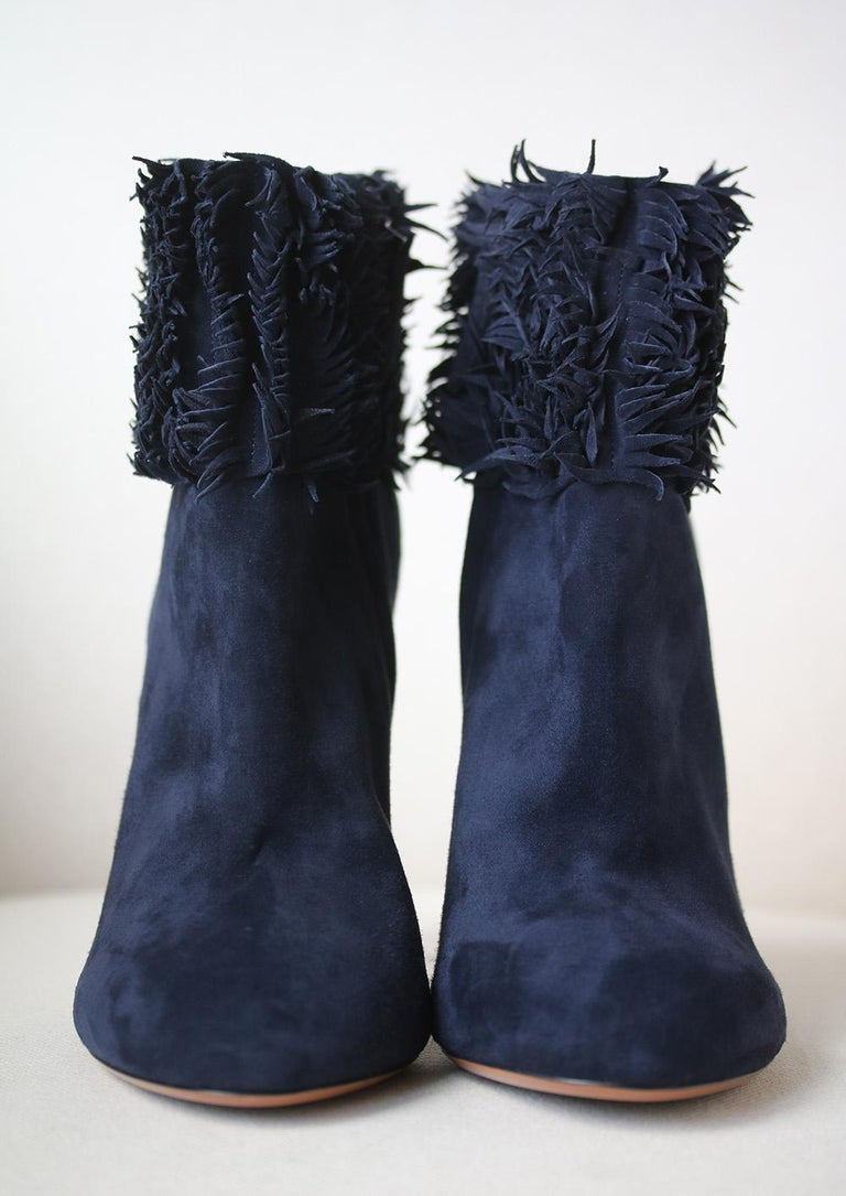 Navy suede Alaïa ankle boots with tonal stitching, fringe trim at top lines, covered heels and zip closure at sides. Includes dust bags.  Size: EU 41 (UK 8, US 11)  Heel measures approx. 4.75