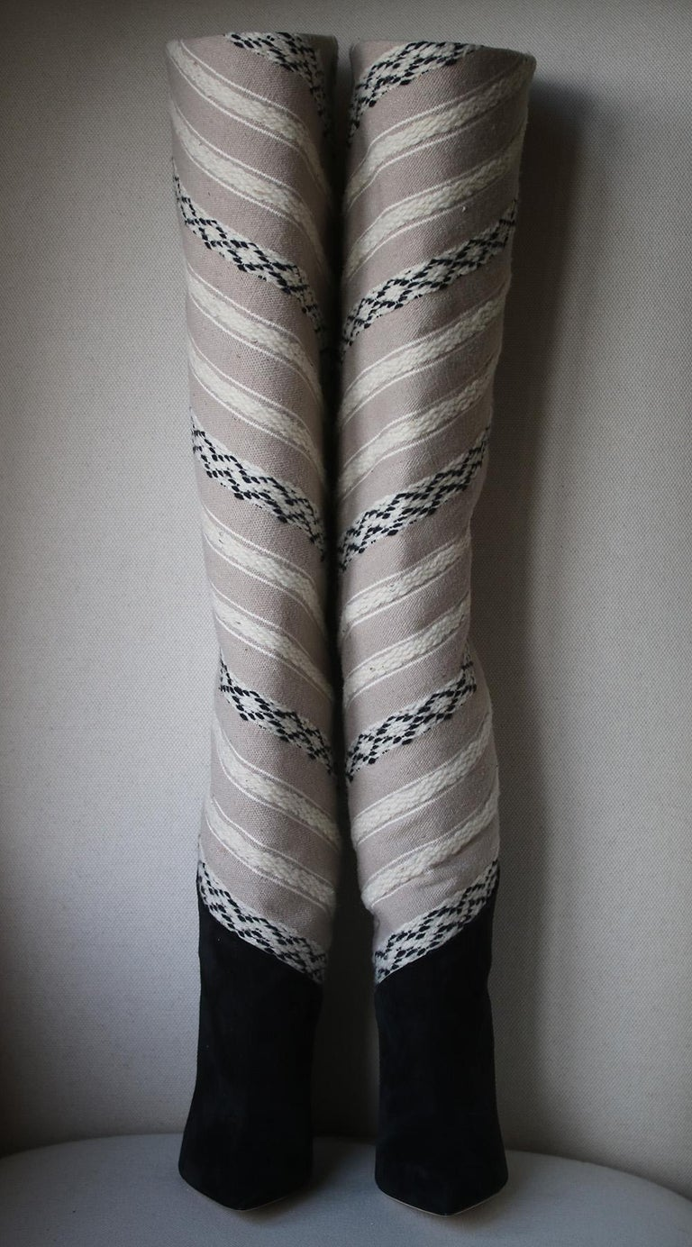 Thigh boots embroidered with ikat fabric motifs, with a suede pointed toe and tall, stacked heel. Leather sole. 100% Calfskin leather. Color: black.  Size: EU 38.5 (UK 5.5, US 8.5)  Condition: New without box.