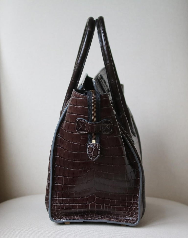 Celine Crocodile Handbag with Goldtone Hardware in beautiful crocodile leather in the most beautiful rich chocolate brown colour with tonal stitching.    Condition: Excellent used condition. Leather is still stiff. A few minor marks inside and