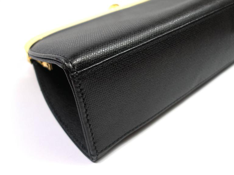 9a5acbbb3b Yves Saint Laurent Clutch Gold Hadware Black leather For Sale at 1stdibs
