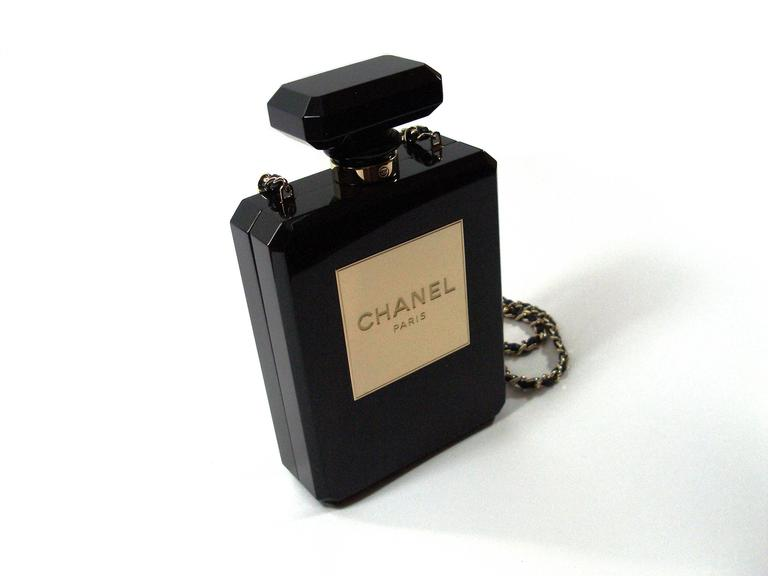 The ultimate clutch for the Chanel lover/collector  So EXQUISITE....  it is like a work of art ULTRA COLLECTOR / VERY RARE IN BLACK  Currently only  one for sale on the world (clear) at a price of 13500 usd  Authentic Chanel black Perfume Bottle bag