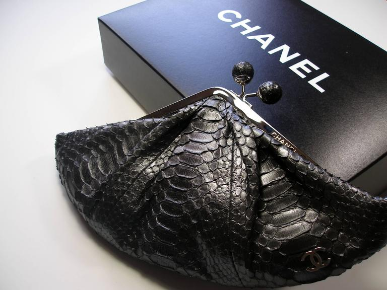 Chanel  python clutch And gray satin interior Color: silver gray LIMITED EDITION Code date inside 12.... CC Chanel logo in silver plated Very original closing system Dimensions: L 30 X H 15 X D 4 cm Comes with box and chanel dustbag Please note : a