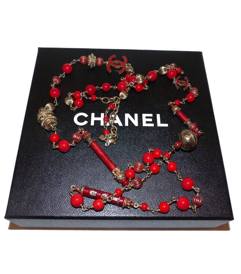 Beautiful necklace Chanel Paris Shanghai collection arts and crafts collection Red glass beads and gold brushed metal Chinese charms and double chanel symbol C Lobster clasp closure Chanel signature plaque Excellente Condition  Its comes with Chanel