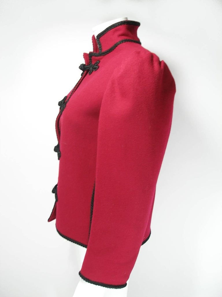 Impossible to find  Aboluty Collectible  Yves Saint Laurent, Red / bordeaux color, wool, Russian collection jacket, with puff sleeve, detail, Mandarin collar and black Passementerie trim. This color is Fantastic !  Designer: Yves Saint Laurent Place