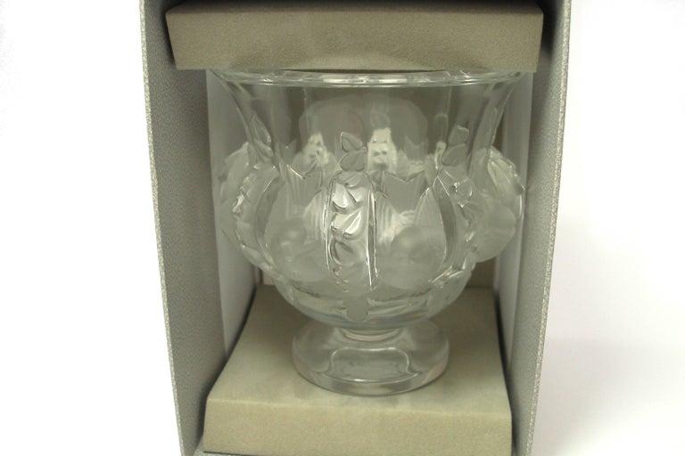 FANTASTIC and CLASSIQUE       DAMPIERRE Vase de chez Lalique       Handcrafted vase.     24% lead crystal.     Approximately  :     Diamètre base : 6 cm      Diamètre du haut : 11.5 cm     Hauteur : 12.2 cm      Made in France.     Signed