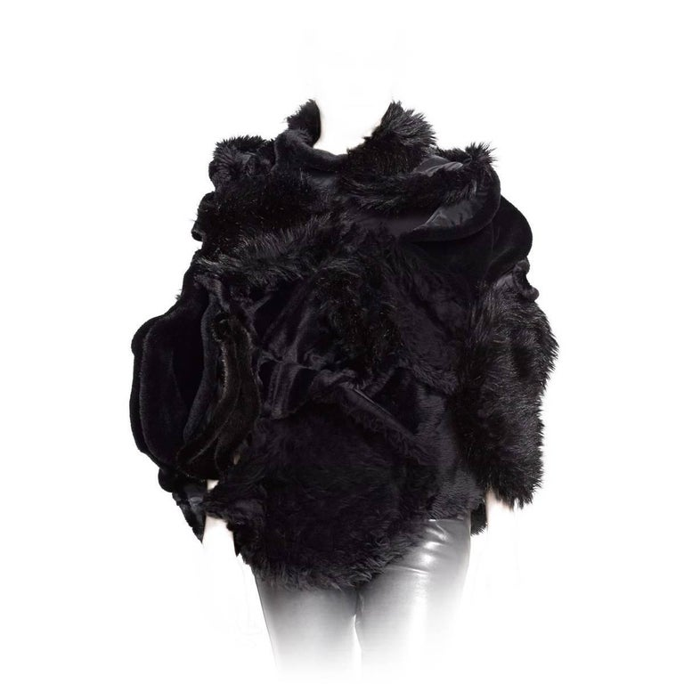 Faux shearling and faux fur add lavish textural dimension to this artfully draped and gathered Junya Watanabe cape jacket.      29