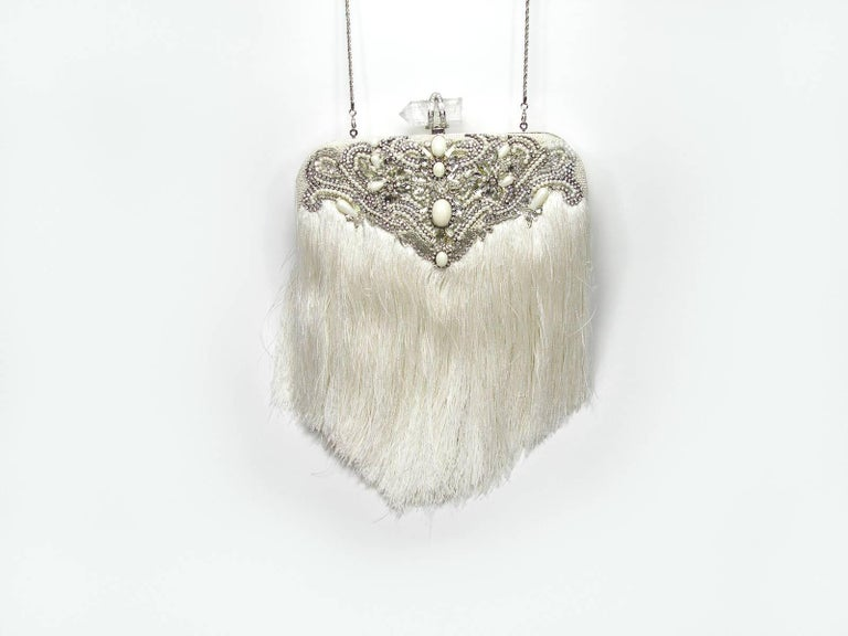 Magnificent Piece by Couture Marchesa Embroidered and embellished with stones Removable  chain shoulder strap with Fringe Interior lining with a slip pocket Frame opening with push-lock closure, embellished with crystal stones  Size: 25 X 20 X4 cm