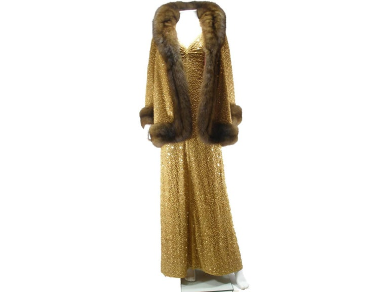 Exceptional Pièce Museum  Suite Evening Dress and Jacket Chanel Haute Couture Gold cloque silk embroidered sequins and Zibeline  Runway press of 1977 ( see photo )  Size estimed : 38 FR or 8 US Please note : no label of composition , no size tag ,