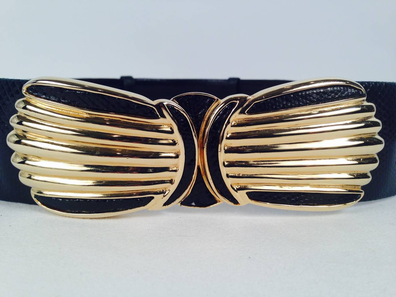 Cinch your waist with this unforgettable belt by Judith Leiber!  More than just the