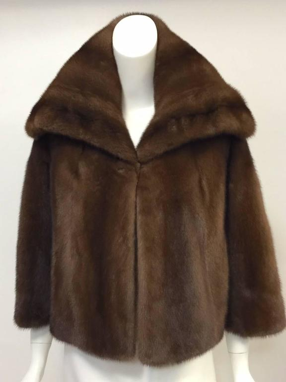 """This Brown Mink Coat proves that Mary McFadden is much more than extensive beading and her trademarked pleated fabric!  Features beautiful brown pelts deserving of the """"Platinum Fur"""" registered trademark and label.  Classic short swing silhouette is"""