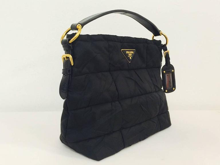 6f09cf8428fa3 Prada Nylon Handbag With Patent Leather Handle is a must for any fan of Miu  Miu s